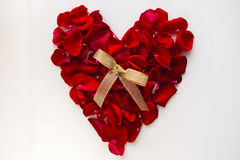 Red heart made of rose petals Royalty Free Stock Photography