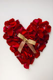 Red heart made of rose petals Royalty Free Stock Image