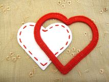 Two loving hearts. Red heart made of yarn and white paper heart together royalty free stock image