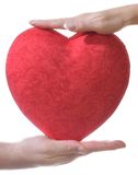 Red heart in male and female hands Royalty Free Stock Photos