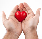 Red heart in male hands. Royalty Free Stock Images