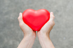 Red heart in man hands Royalty Free Stock Photo