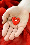 Red heart in a man's hand Royalty Free Stock Photography