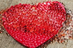 Red heart with many small transparent pearl Royalty Free Stock Images
