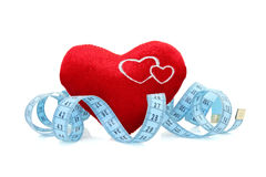 Red heart with measure tape Stock Photo