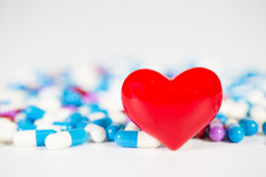 Red heart with medical drug. Background royalty free stock images