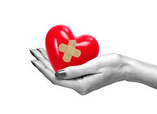 Red heart with medical path in woman hand, isolated on white. Background stock photography