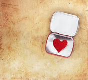 Red heart in a metal tin Stock Photography