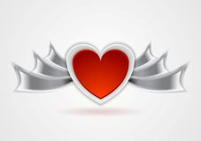Red heart with metal wings Royalty Free Stock Photography