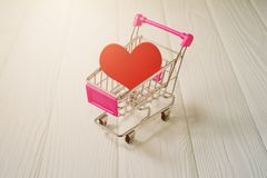 Red heart in a mini supermarket trolley Royalty Free Stock Images