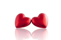 Red heart with mirror reflection. Two festive hearts for Valentine's day. With mirror reflection Royalty Free Stock Photography