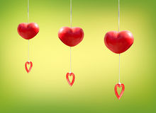 Red heart mobile hanging on green Stock Photography