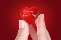 Red heart of mothers day in woman hand Royalty Free Stock Photo