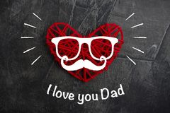 Red heart with a mustache and glasses. Feast, Father`s Day. stock photo