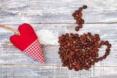 Red heart near coffee beans. Stock Image