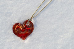 Red Murano heart necklace in snow Royalty Free Stock Image