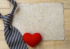 Red heart and necktie on natural paper texture Stock Photography