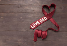 Red heart necktie is on wooden background Stock Photography