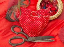 Red heart needle pillow Stock Image