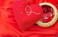 Red heart needle pillow Stock Photo