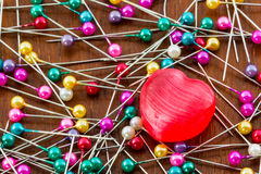Red heart and needles. Royalty Free Stock Photography