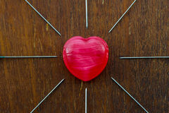 Red heart and needles. Stock Photography