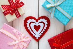 Red heart next to the gift boxes Stock Image