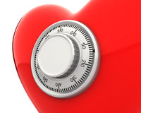 Red heart with a numeric safe lock closeup Stock Image
