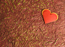 Red heart on old red. Red heart with old red in the background Royalty Free Stock Photo