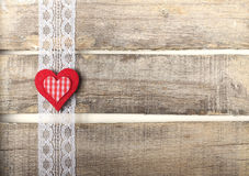 Red heart on old wooden background. With lace Royalty Free Stock Image