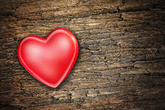 Red heart on old wooden background Stock Image