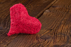 Red heart on old wooden board Royalty Free Stock Photography
