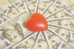Red heart and one hundred dollar banknotes. Background Stock Images