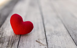 Red heart over blurred wood background royalty free stock image