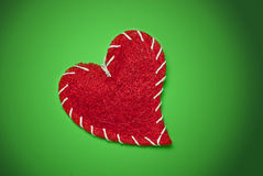 Red heart over green Stock Image