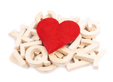 Red heart over the pile of wooden letters Royalty Free Stock Images