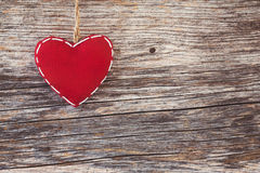 Red heart over wooden background. Toned, vintage style, copy space Stock Photography