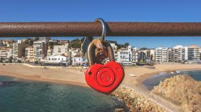 Red Heart Padlock in Brown Metal Pipe in Front of Seashore during Daytime Stock Images
