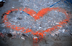 Red heart painted on concrete stock photos