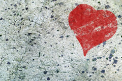 Red heart painted on gray rock surface texture, love background Stock Photo