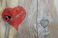 Red heart painted on wood and knothole in heart shape, love back Royalty Free Stock Photo