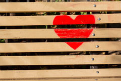 Red heart painted on a wooden bench Stock Images