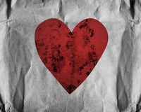 Red heart on paper. Background Stock Image