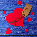 Red heart paper cut on blue wooden background. Royalty Free Stock Photography