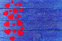 Red heart paper cut on blue wooden background. Royalty Free Stock Photos