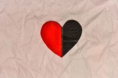 Red heart paper cut on brown paper in pin on white background Royalty Free Stock Image