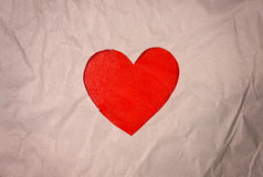 Red heart paper cut out on background brown paper Stock Image