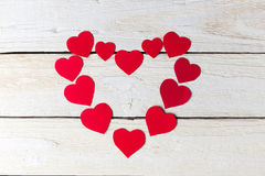 Red heart paper cut on white wooden background. Stock Images