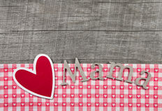 Red heart with paper letters 'Mama Stock Photos