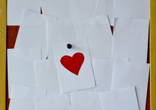Red heart paper note on noticeboard Stock Photography
